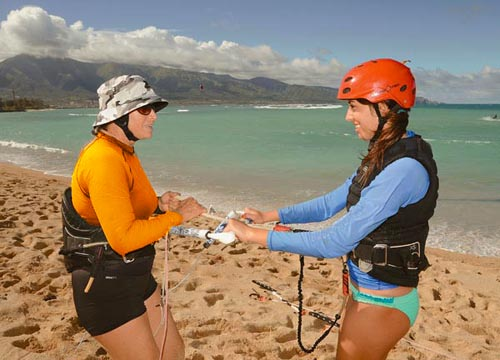 Aqua Sports Maui Kiteboarding Instructor Karen Lang teaching at Kite Beach Maui